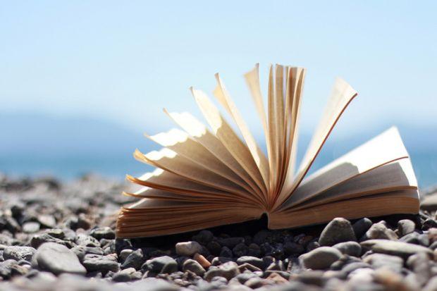An open book on a beach