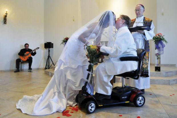 Archbishop Richard Gundrey performs wedding ceremony, Pojoaque, New Mexico