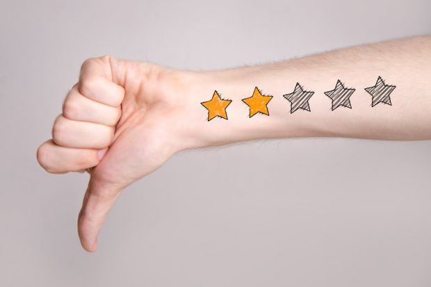 Arm with thumb down and low star rating