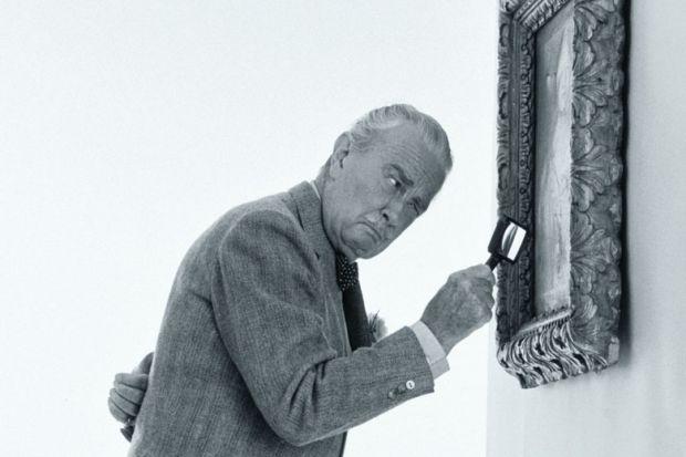 Art critic examining painting