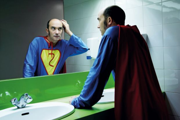 Balding superhero checking hair in mirror