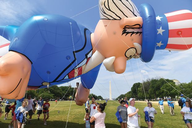 Participants pulls a balloon for the Independence Day parade in Washington, DC, illustrating review of 'This Is Not Normal: The Politics ofEveryday Expectations' by Cass R. Sunstein