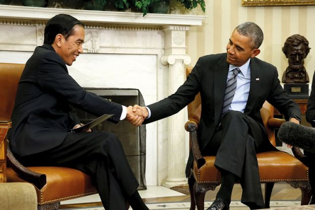 Barack Obama and Joko Widodo shaking hands, Oval Office, White House