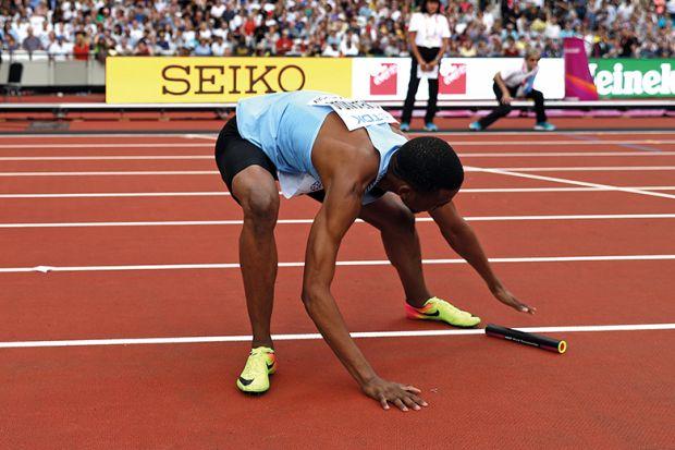 Relay runner with baton