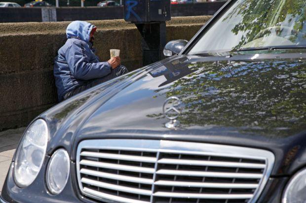 Beggar next to Mercedes