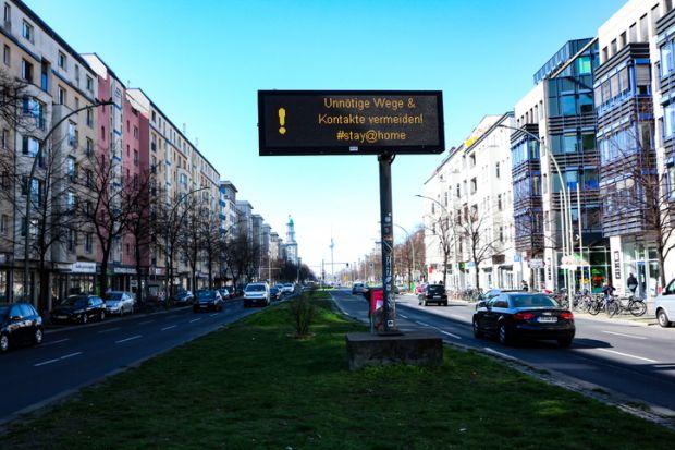 Berlin traffic billboard with health advice during coronavirus shutdown