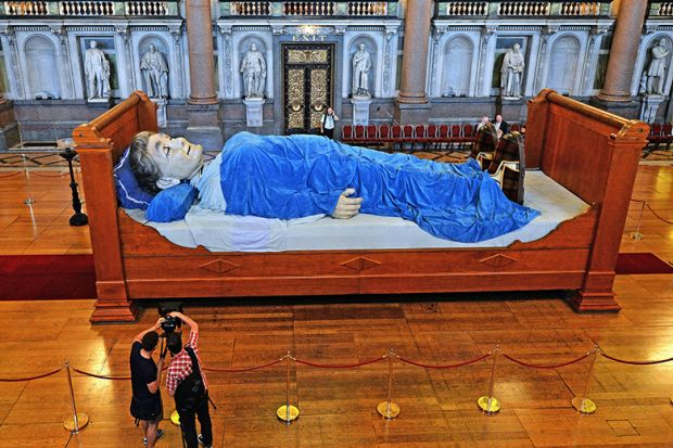 Sculpture of giant in bed