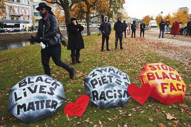 Human rights activists attend a rally against blackface characters during the Saint Nicholas parade in The Hague, Netherlands, 2019
