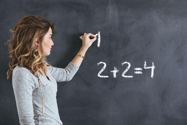 woman writes on blackboard