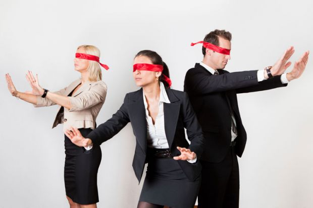 Blindfolded business people holding arms out