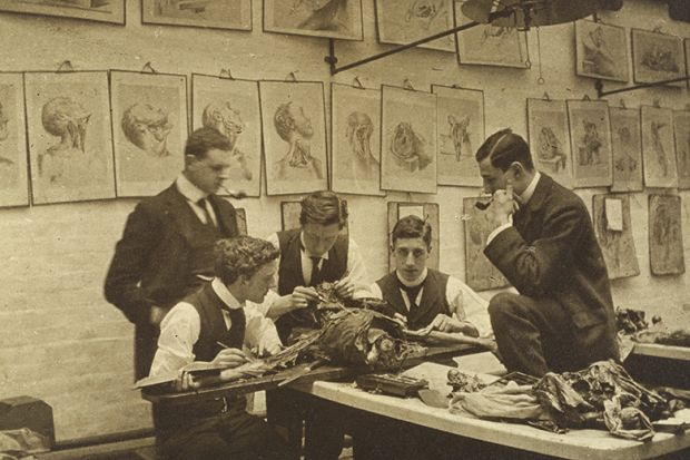 The interior of a dissecting room: five students and/or teachers dissect a cadaver