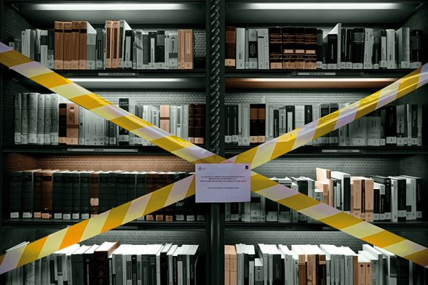 Books on taped-off library shelf