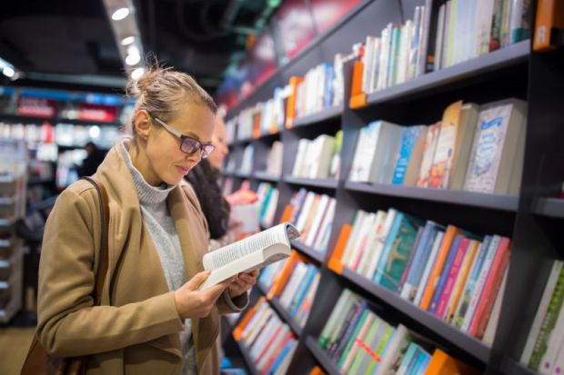 woman reading in a bookshop