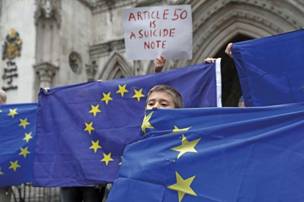 Boy shrouded in EU flag