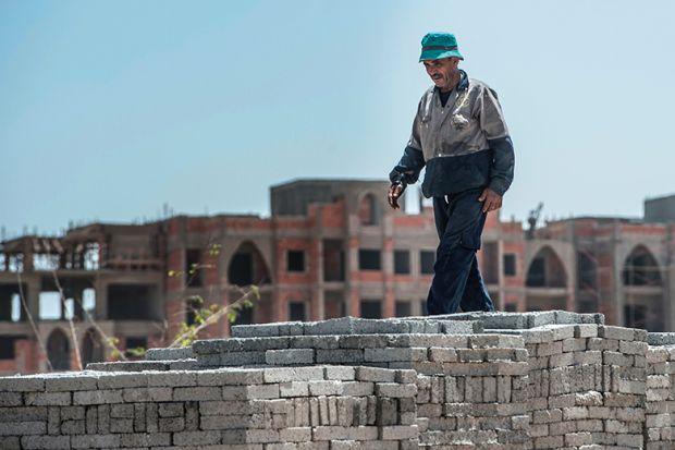 Man with bricks