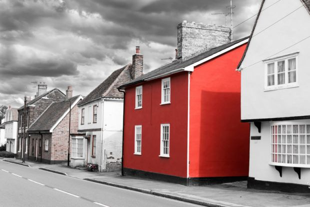 Bright red house on washed-out British street