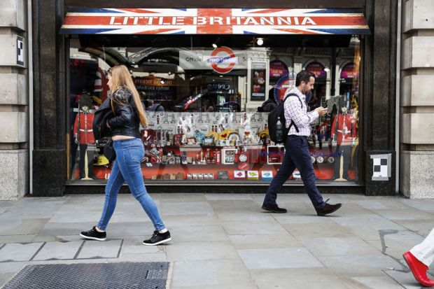 People walking past Little Britannia shop, London