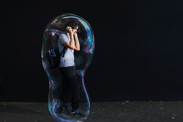 Young man inside giant bubble