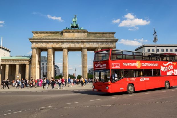 A double-decker bus at the Brandenburg Gate