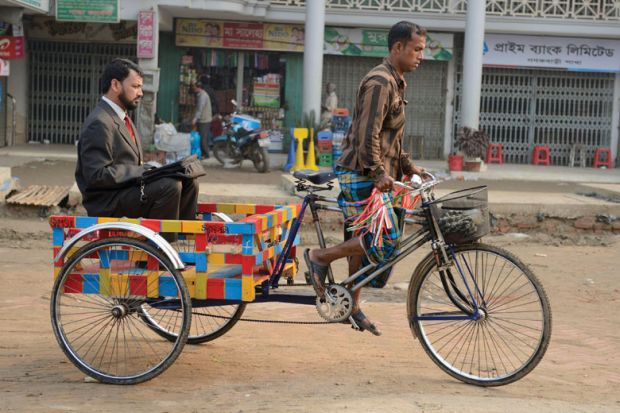 Businessman being transported on rickshaw