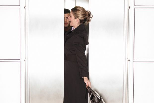 Businesswoman squeezing through elevator/lift doors