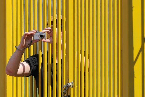 Camera through a fence