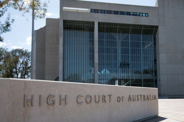Canberra, Australia - March 10, 2020 Ground-level external view of the High Court of Australia building, characterized by a large inscribed granite sign on the site