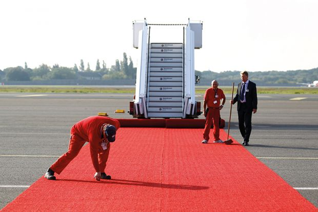 rolling out red carpet at airport