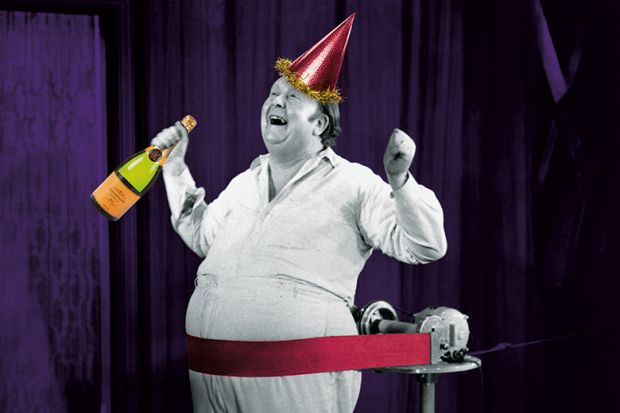 Man celebrates with champagne and party hat