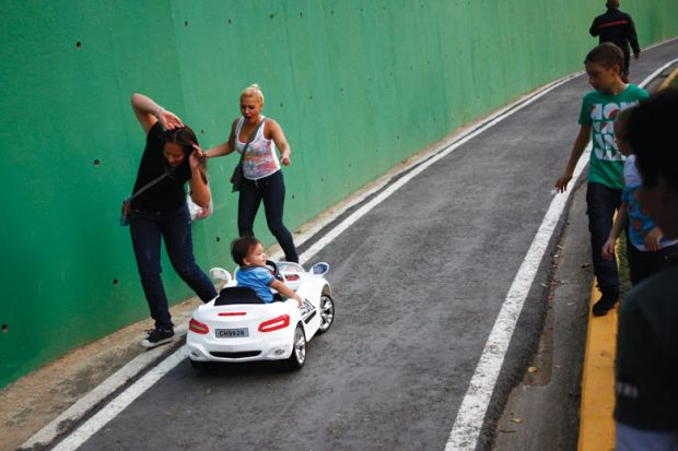 Child drives miniature car into people