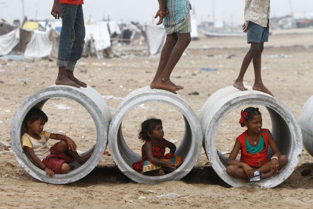 Children inside water pipes, Marina Beach, Chennai, India