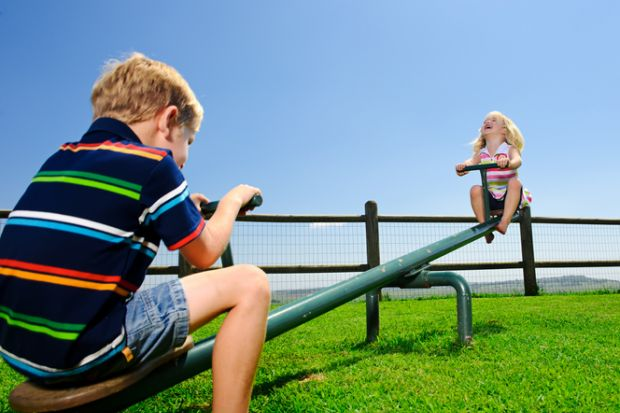 Children on the seesaw in a playground