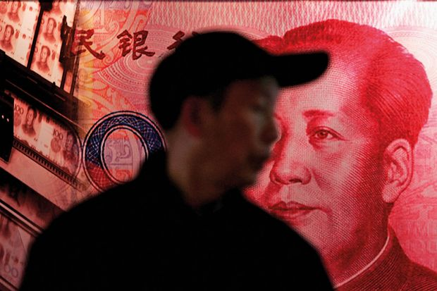 Man with image of Chinese banknote