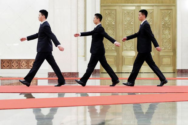 chinese men walking