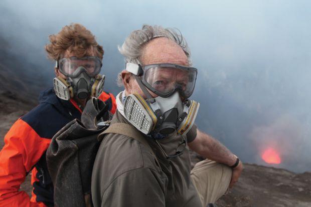 Clive Oppenheimer and Wwerner Herzog standing beside volcano