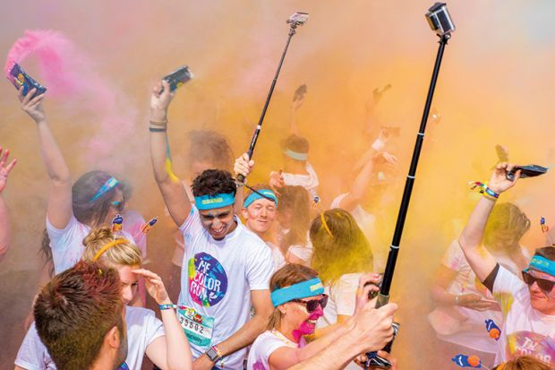 Birmingham Color run 2016. Young people with selfie sticks