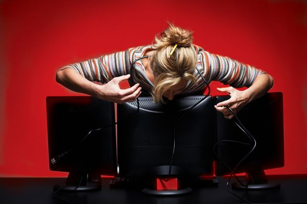 Woman leaning over computer