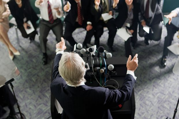 A man speaking at a news conference