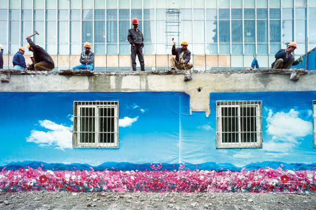 Construction crew dismantle a building, Shanghai, China