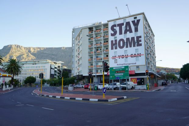 a building with a coronavirus lockdown sign in Cape Town