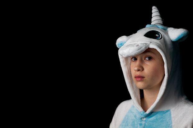 student in unicorn onesie