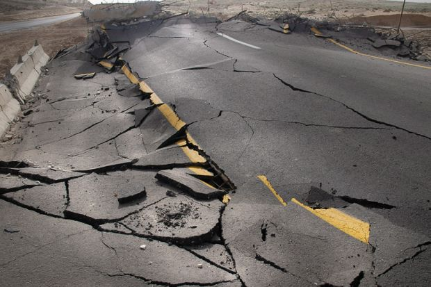 Cracked road damaged by earthquake