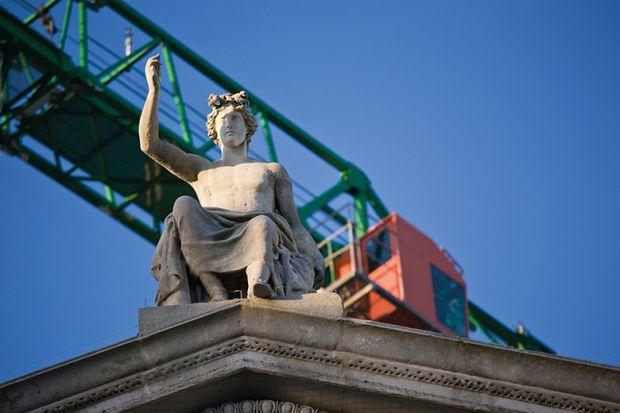 statue and crane