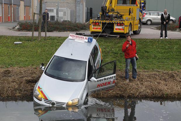 Car at edge of lake