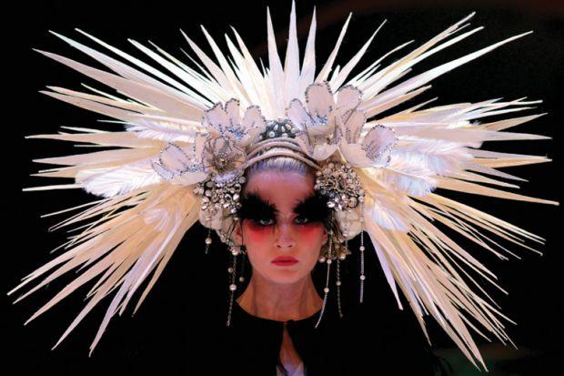 Female model wearing elaborate headdress