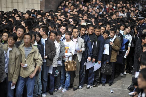 Crowd of graduates waiting for job fair, China