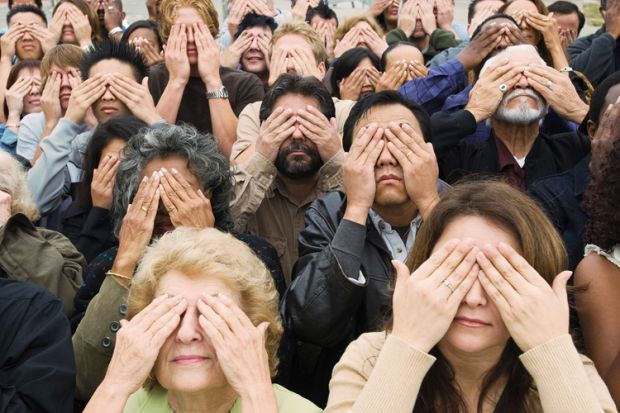 Crowd of people covering eyes