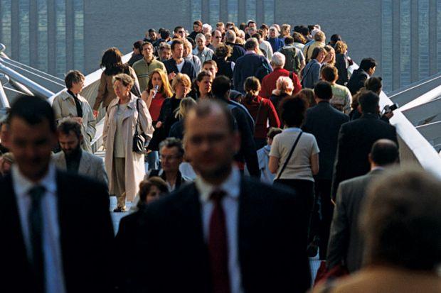 Crowd of people on Millennium Bridge, London