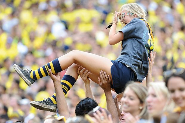 Student lifted by crowd
