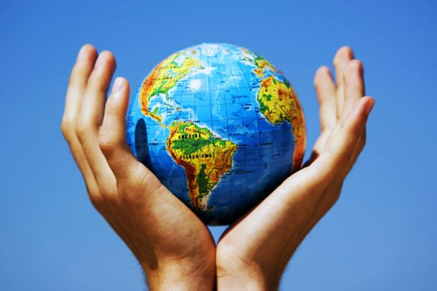 Cupped hands holding globe aloft